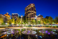 Fountains and buildings at Lebauer Park at night, in downtown Gr stock image