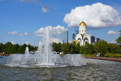 Fountains at the Cathedral of St. George.  Moscow. Poklonnaya Gora.view of the Church of St. George.a complex of fountains Royalty Free Stock Photo