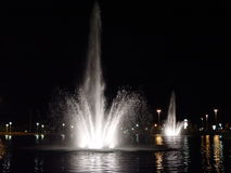 Fountains in the City. Fountains photographed at night in a city in Delaware Stock Images