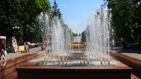 Fountains in city park stock video footage