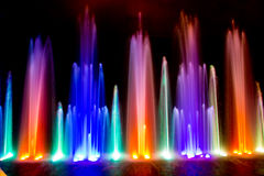 Fountains. Dancing fountains illuminated with different colors stock photos