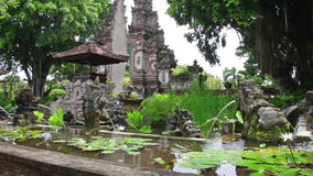 Fountains in form of stone lions - traditional Buddhist culture to Bali stock footage