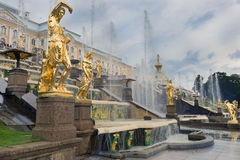 Fountains Grand cascade in Pertergof, neighborhood of Saint-Petersburg. Gold plated sculptures by fountains Grand cascade in the Lower Park in Pertergof Royalty Free Stock Images