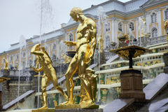 Fountains Grand cascade in Pertergof, Saint-Petersburg, Russia. Gold plated sculptures by fountains Grand cascade in Pertergof, Saint-Petersburg, Russia Royalty Free Stock Photos