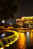Fountains illuminated with lights at night time Royalty Free Stock Photos