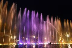 Fountains illuminated at night Stock Image