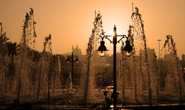 Fountains and lanterns at sunset Royalty Free Stock Photos