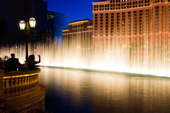 Fountains in Las Vegas at night. Tourists watching fountains in Las Vegas stock images