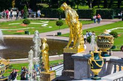 Fountains in the lower garden of Peterhof Stock Photos