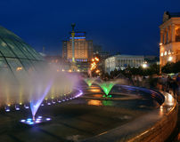 Fountains on Maidan Nezalezhnosti square- evening. Illuminated Maidan Nezalezhnosti square & x28;Kiev& x29;. Fountains in foreground Royalty Free Stock Images