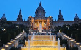 Fountains at National Palace Palau Nacional at dusk, Barcelona, Spain royalty free stock photos