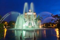 Fountains near Patuxai monument, Vientiane, Laos. Fountains near Patuxai monument at night, Vientiane, Laos stock photo