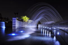Fountains at night Stock Images