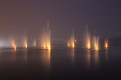 Fountains in the night Stock Photos