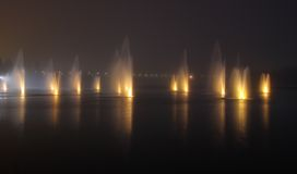 Fountains in the night stock photo
