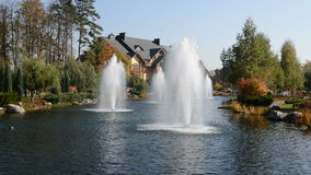 The fountains and. NOVI PETRIVTSI, UKRAINE - OCTOBER 14: The fountains and Khonka house in Mezhigirya on October 14, 2014 in Novi Petrivtsi, Ukraine. It is stock video footage