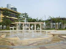 Fountains over decorated terrace, Sanya. Image shows fountains cascading over a decorated terrace-type area that serves as an entrance to a hotel complex in Royalty Free Stock Photos