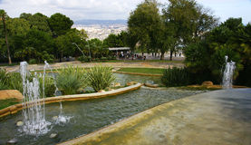 Fountains and pond with Barcelona at background Royalty Free Stock Photography