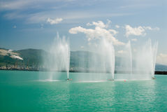 Fountains in a sea bay. Russia. Fountains in a bay of the city of Novorssijska Stock Photos