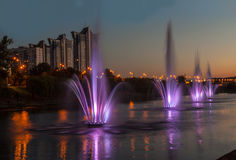 Fountains with soundlights on Rusanivska embankment in Kiev Royalty Free Stock Photography