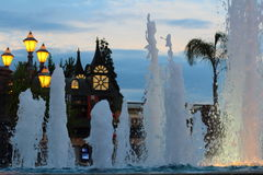 Fountains at Theme Park by twilight sky Stock Photo