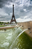 Fountains of Trocadero in Paris. Fountains of Trocadero with Eiffel Tower against dramatic sky, Paris, France Stock Photos