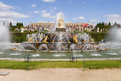 Fountains at Versailles. A view of the palace of Versailles from the Fountain of Latona which is one of the main ornamental fountains in the gardens. Streams of royalty free stock photos
