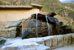 The Fountains of the Water Temple Still in the Original State of the Inca Empire, Ollantaytambo Fortress Ruins, Cusco, Peru stock photo