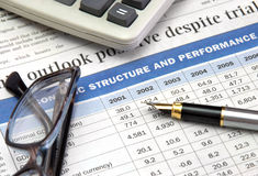 Fountan pen. Gold fountain pen, eyeglasses and calculator on the table of financial statement Stock Photography