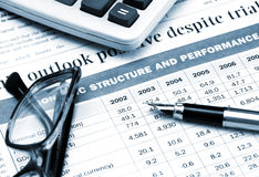 Fountan pen. Fountain pen, eyeglasses and calculator on the table of financial statement Royalty Free Stock Photos