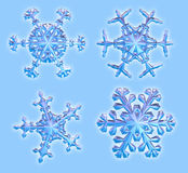 Four 3D Snowflakes - includes clipping path Stock Image