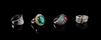 Four (4) Diamond rings Royalty Free Stock Photos
