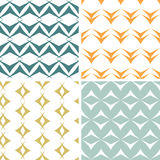 Four abstract arrow shapes seamless patterns set Royalty Free Stock Images
