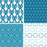 Four abstract blue tulip shapes seamless patterns Stock Photos