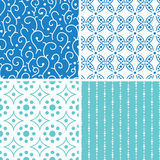 Four abstract doodle motives seamless patterns set Royalty Free Stock Images