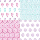Four abstract feather motives seamless patterns Stock Images