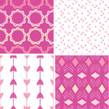 Four abstract geometric pink seamless patterns set Royalty Free Stock Images