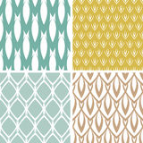 Four abstract ornamental shapes seamless patterns set Stock Image