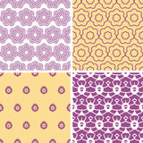 Four abstract purple and gold oriental motives seamless patterns set Royalty Free Stock Images