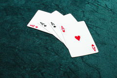 Four ace. Cards of four aces in green flannelette background Royalty Free Stock Photos