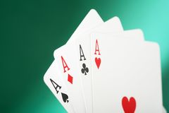 Four aces. Against a green background Stock Photography