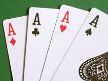 Four Aces. On a green background royalty free stock photos