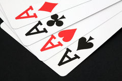Four Aces. From all four suits of playing cards on blackground Royalty Free Stock Photos