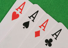 Four Aces. On green table Royalty Free Stock Image