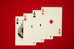 Four aces. Poker hand, for of one four aces on red felt Stock Images