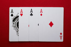 Four aces. Poker hand, for of one four aces on red felt Royalty Free Stock Images