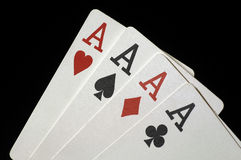 Four Aces. On Black royalty free stock photo