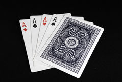 Four Aces. A hand of four aces and an uncovered card Royalty Free Stock Photos