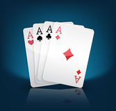 Four aces. Playing cards suits on blue Stock Photos