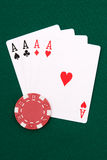 Four aces. And red chip on green linen stock images